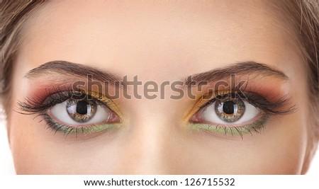 beautiful female eyes with bright autumn make-up - stock photo