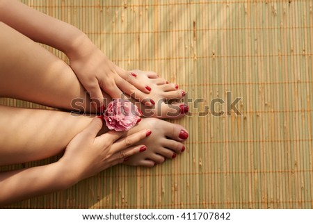 Beautiful female feet and hands after spa procedure - stock photo