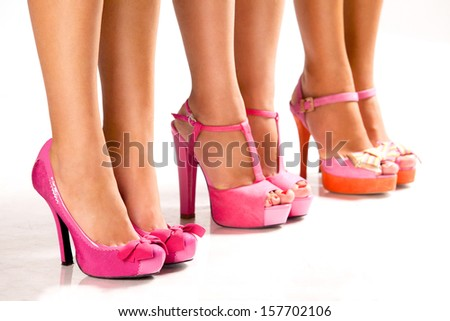 Beautiful female feet in footwear, isolated on a white background - stock photo