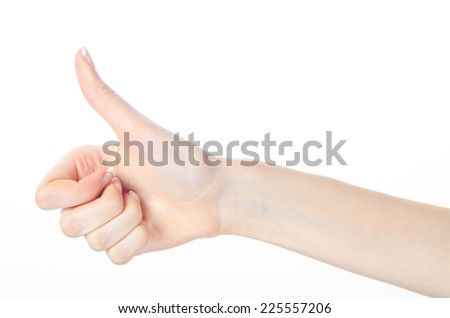 Beautiful female fingers showing thumbs up isolated on white background.