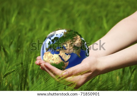 Beautiful female hand holding the Earth - stock photo