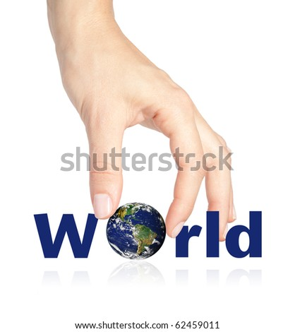 Beautiful female hand placing the earth completing the word world - stock photo
