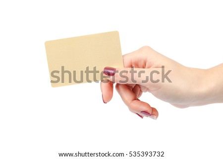 Beautiful female hand with manicure holds a gold card isolated on white background.