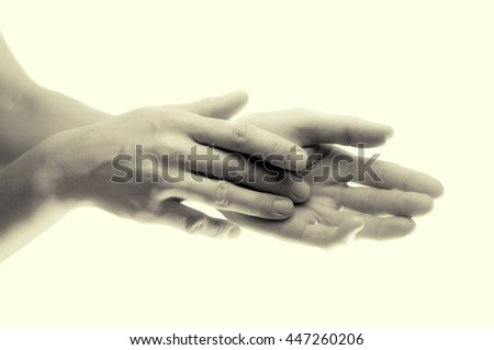 Beautiful female hands, close up, b/w  isolated on toned background - stock photo