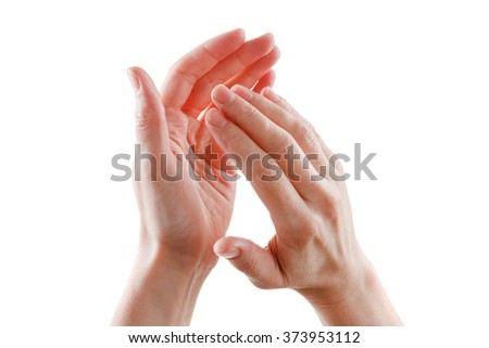beautiful female hands isolated on white background giving applause - stock photo
