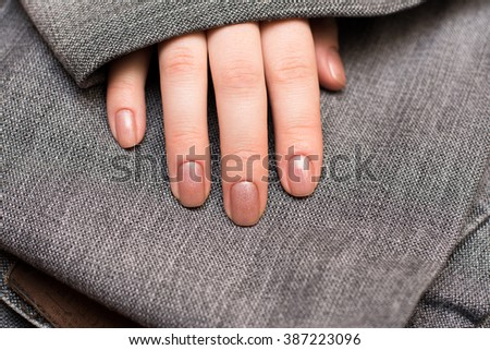 Beautiful Female Hands.Manicure concept Gold Monkey Jeans - stock photo