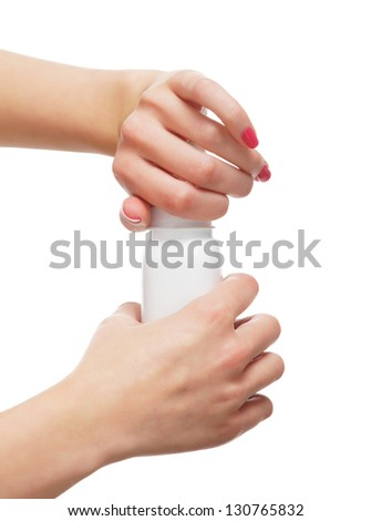 Beautiful female hands opening the bottle with a talcum powder isolated on white
