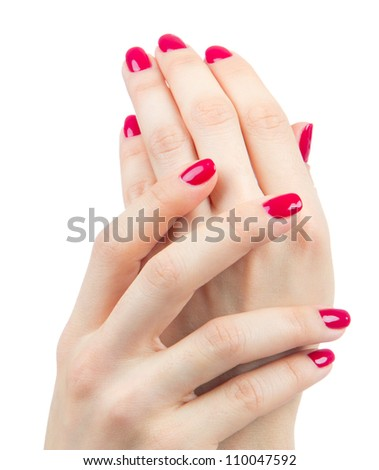 Beautiful Female Hands red manicure shellac  near face concept on a white background. Focus on hand - stock photo