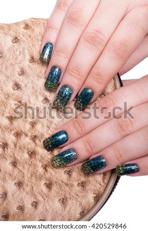 beautiful female hands with professional manicure close-up. Isolated on white background. design of nails snakeskin. - stock photo