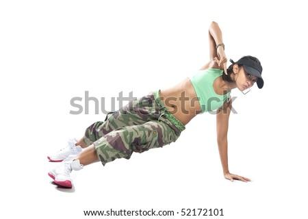 Beautiful female hip hop dancer striking a dance pose. - stock photo