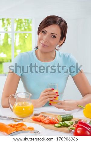 beautiful female holding glass of juice of orange  - stock photo