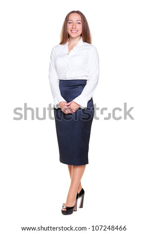 beautiful female in formal clothes standing over white background