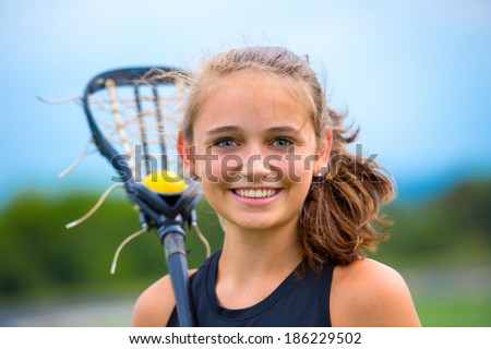 Beautiful female lacrosse player portrait, outdoors before game. - stock photo