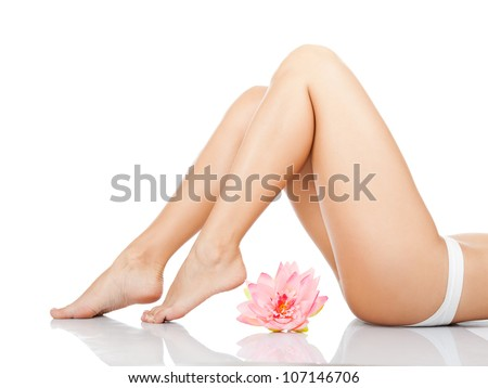 Beautiful female legs, ass back body isolated over white background. lying on the floor white panties pink flower long leg, Beauty spa and skin care concept. - stock photo