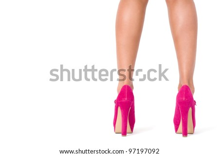 Beautiful female legs in pink shoes - stock photo
