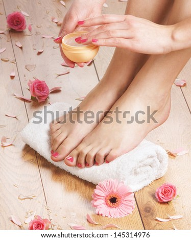 Beautiful female legs in spa composition - stock photo