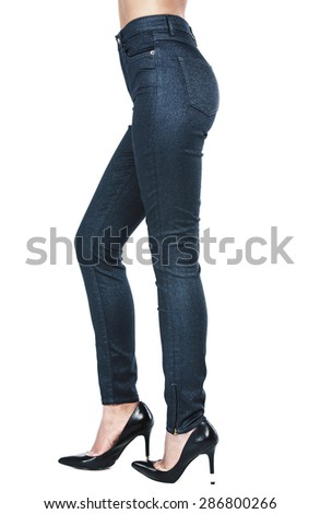 Beautiful female legs in trousers and shoes