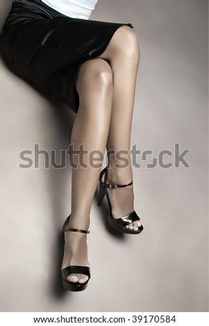 Beautiful female legs, studio shot - stock photo