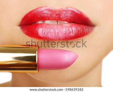 Beautiful female lips with lipstick, close up - stock photo