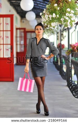 Beautiful female model with shopping bag. Full length portrait  - stock photo