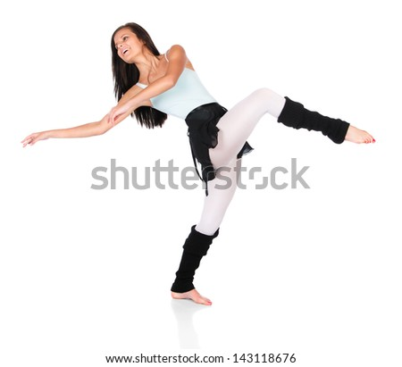 Beautiful female modern jazz contemporary style dancer isolated on a white background. Dancer is wearing a blue leotard, black skirt and leg warmers. - stock photo