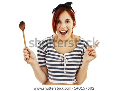 Beautiful Female Pin-up Chef Thinking Up Creative Cooking Ideas With Wooden Spoon. Isolated On White Background - stock photo