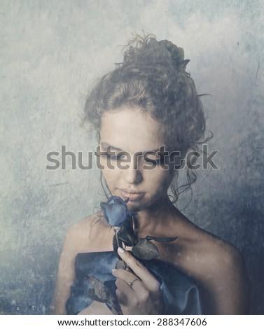 Beautiful female portrait with blue rose - stock photo