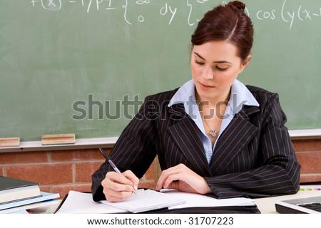 beautiful female school teacher preparing for the class - stock photo