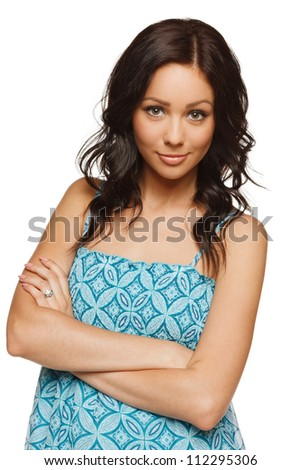 Beautiful female standing with folded hands, over white background - stock photo