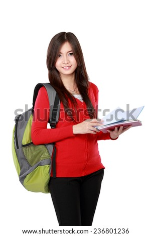 Beautiful female student holding books and smile to the camera isolated on white background - stock photo