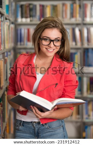 Beautiful Female Student In A University Library - A Portrait Of An Caucasian College Student Girl In Library - Shallow Depth Of Field - stock photo