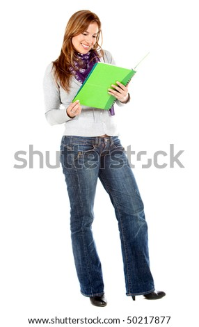 Beautiful female student reading a notebook isolated over a white background