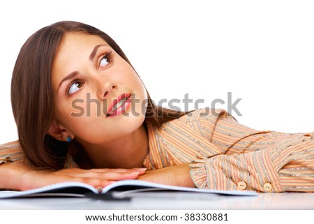 Beautiful female student smiling and looking away over white background - stock photo