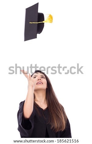 Beautiful female student throws up his graduation cap in celebration.White background  - stock photo