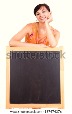 beautiful female teacher with blackboard, white background - stock photo