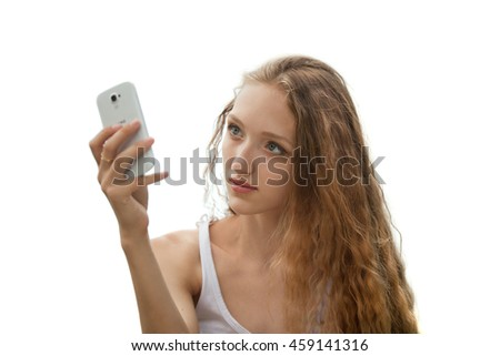 Beautiful Female Teenager Taking a Selfie with Phone Outdoors