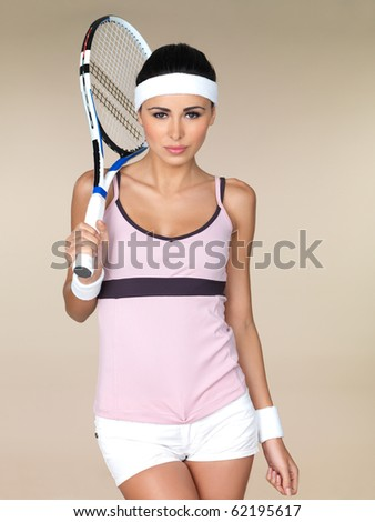 Beautiful female tennis player on natural background - stock photo