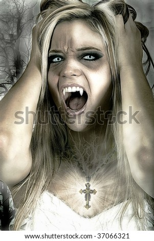 Beautiful female vampire wearing cross - stock photo
