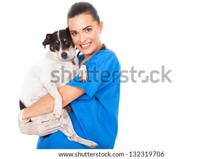 beautiful female vet doctor hugging pet dog - stock photo