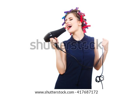 Beautiful female vocalist sings while doing morning toilet. Isolated. - stock photo