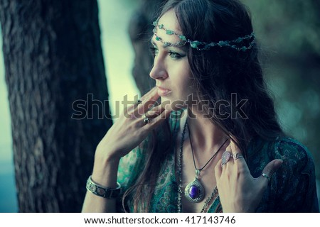 Beautiful female warrior in armor with a steel sword. Portrait of mystic elf woman with sword.jewelry, necklace, ornate, celtic  - stock photo
