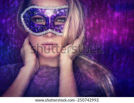 Beautiful female wearing mask, mysterious girl with nice makeup at masquerade, stylish woman portrait studio shot over party light background, holiday celebration - stock photo