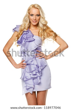 Beautiful female with strong long blond hair posing with hands on hips, over white background