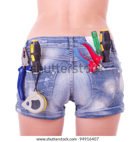 Beautiful female worker with tools in back pocket on shorts on a white background. - stock photo