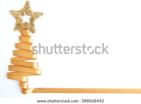 Beautiful fir tree made from satin ribbon, isolated on white - stock photo