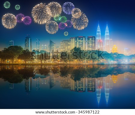 Beautiful fireworks above cityscape of Kuala Lumpur skyline at night, Malaysia - stock photo