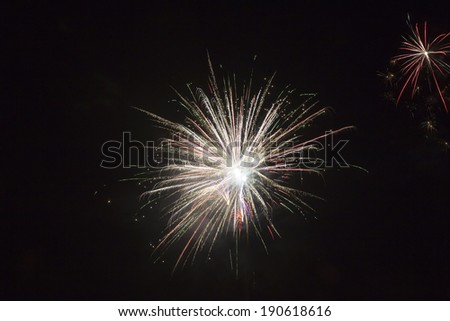 beautiful fireworks against the dark sky, fireworks - stock photo