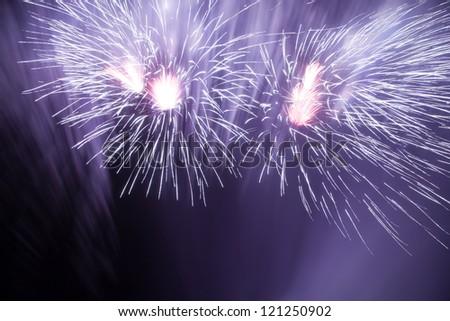 Beautiful fireworks in the night sky - stock photo