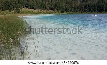 Beautiful fishing lake in British Columbia Canada. This lake has volcanic ash making it look tropical. - stock photo
