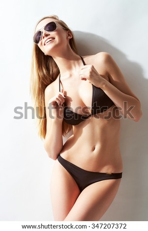 Beautiful, fit and sporty woman in a swimsuit. Fat lose, liposuction and cellulite removal concept. - stock photo